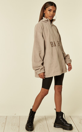 'Baby' oversized slogan fleece with zip in nude by Pharaoh London