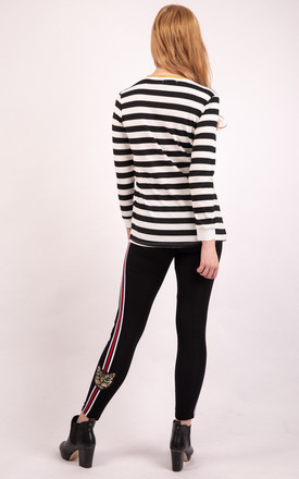 Embroidered Ribbed Knit Top in Black and White Stripe by Urban Mist