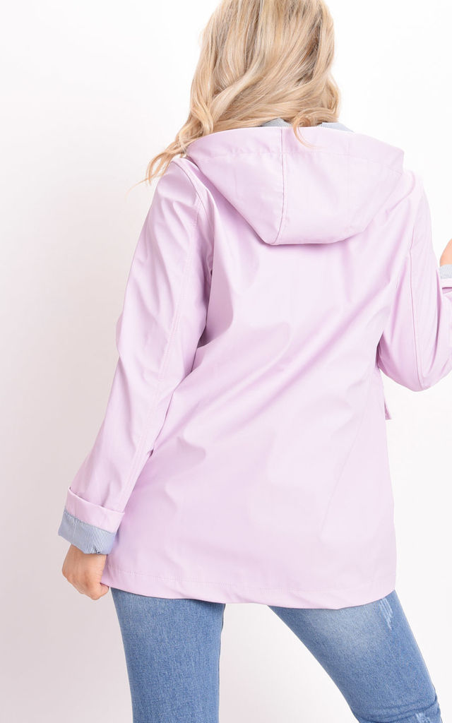 Waterproof hooded rain mac in baby pink by LILY LULU FASHION