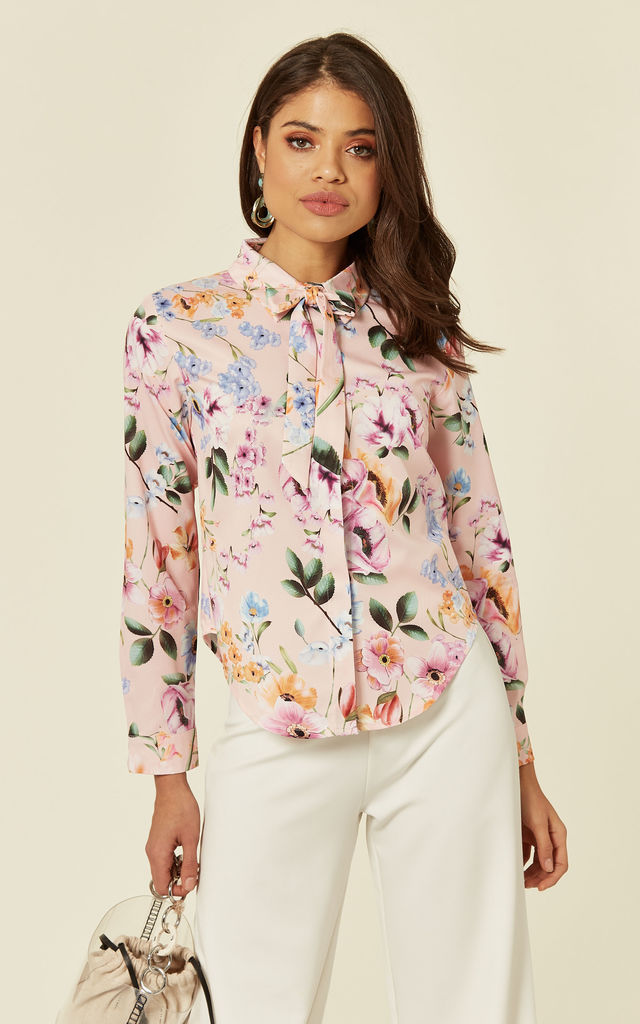 Blouse with Neck Tie Detail in a Pink Floral Print by MISSI LONDON