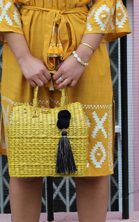 Straw Basket Beach Bag In Yellow With Navy Tassel by Seventy Six Fashion Product photo