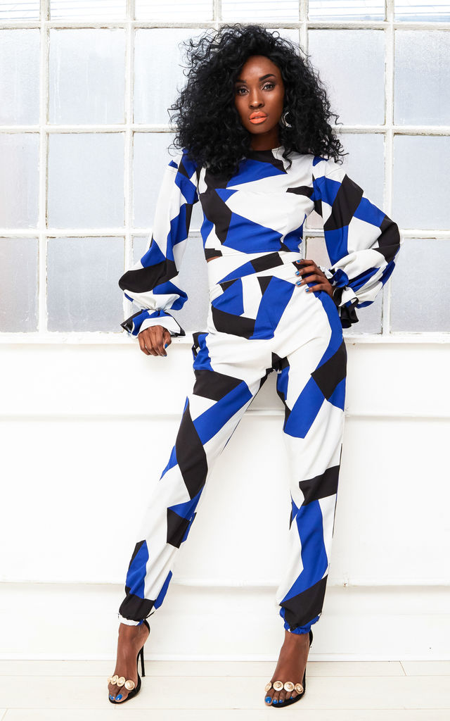 FEMME satin high waist joggers in blue and white geometric print by Dolls Of Decadence