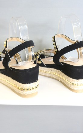 Black studded platform sandals by Bond Street Shoe Company