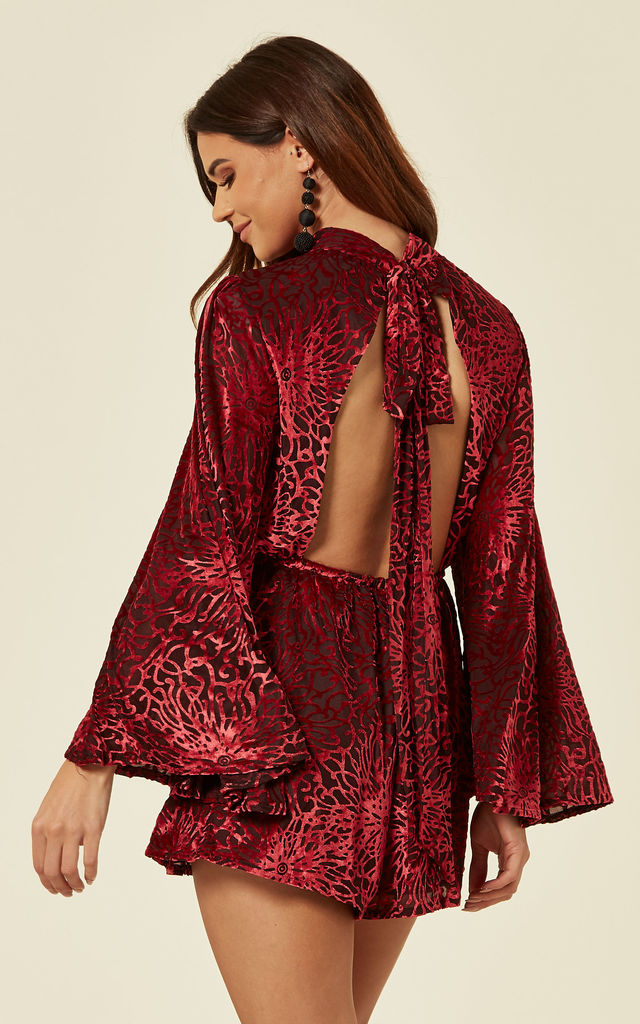 HOW SOON IS NOW - MAROON VELVET FLOWER LONG SLEEVED PLAYSUIT WITH OPEN BACK AND TIE by Wyldr