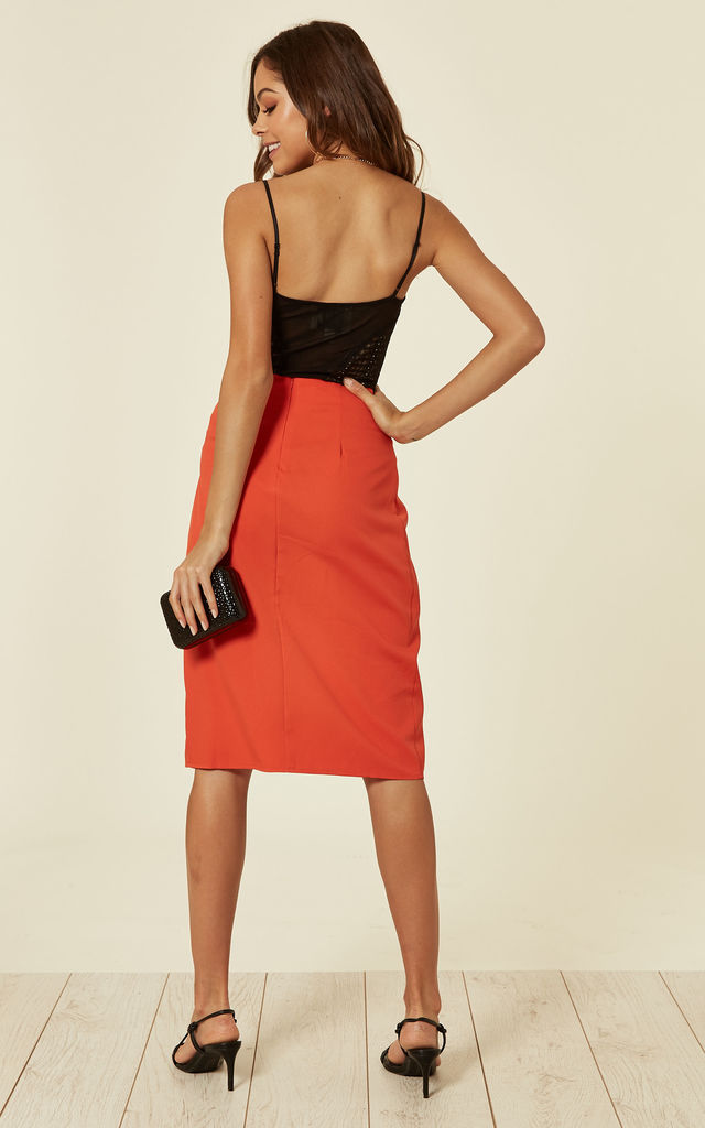 ORANGE ASYMMETRIC SKIRT WITH O-RING DETAIL by Oeuvre