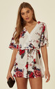 WHITE FLORAL PRINT PLAY SUIT WITH BELT TIE by Oeuvre