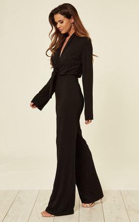 Novello Long Sleeve Jumpsuit with V Neck Tie Front in Black by JAYDE London