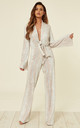 Novello Long Sleeve Jumpsuit with V Neck Tie Front in Snake Print by JAYDE London