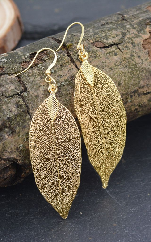 Delicate Leaf Skeleton Gold Drop Earrings With Hooks by Silver Rain
