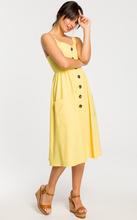 Midi Dress with Side Pockets and Loose Bottom in Yellow by MOE