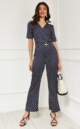 Short Sleeve Wrap Jumpsuit In Navy Polka Dot by Bella and Blue Product photo