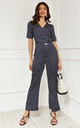 Short Sleeve Wrap Jumpsuit in navy polka dot by Lilah Rose