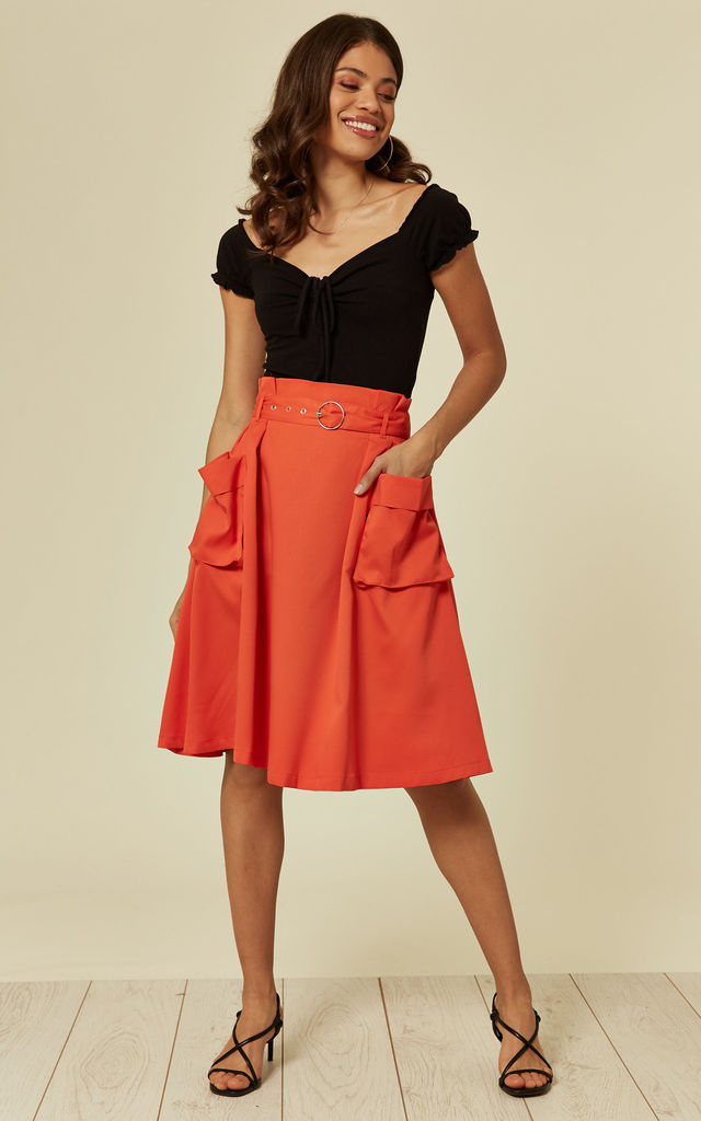 ORANGE MIDI SKIRT WITH SIDE POCKETS AND BELT. by Oeuvre
