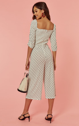 Culotte Jumpsuit with sweetheart neck in white polka dot by Glamorous