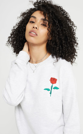Love Wins Rose Embroidered Graphic Sweatshirt by Rani & Co. Product photo