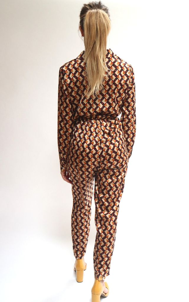 Long Sleeve Jumpsuit with Tie Waist in Geometric Print by Unscripted