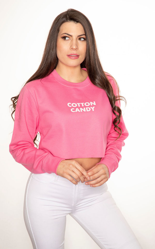 Cotton candy cropped slogan sweatshirt in pink by GET IT GRL