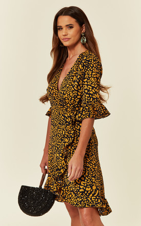 Wrap Playsuit in Leopard Print with Frill Sleeves and Hem by CY Boutique