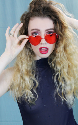 Red heart shaped festival sunglasses by KENNEDY