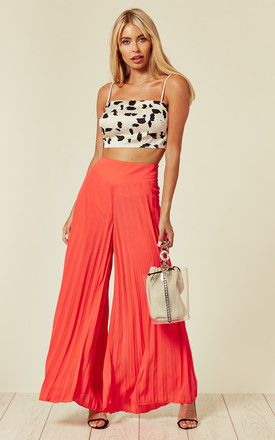 Lulu Pleated Wide Leg Palazzo Trousers In Orange Sunray by SlayTwins Product photo