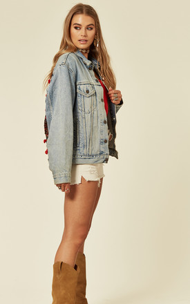 Light Wash Denim Jacket with Embroidery and Pom Poms by Denim Stories