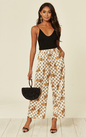 Satin Tiger Print Wide Leg Trousers With Elastics Waist Band And Pockets In White by D.Anna Product photo
