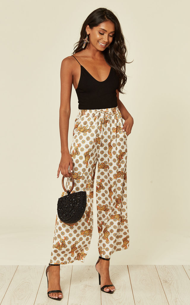 Satin tiger print wide leg trousers with elastics waist band and pockets in White by D.Anna