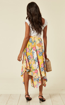Floral print asymmetrical midi skirt in yellow。 by D.Anna