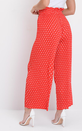 Polka dot pleated wide leg cropped trousers red by LILY LULU FASHION