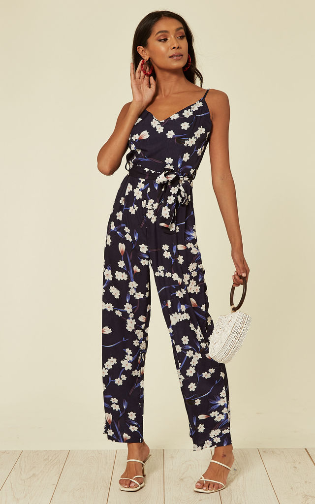 Wrap Front Strappy Jumpsuit in Navy Floral Print by Mela London