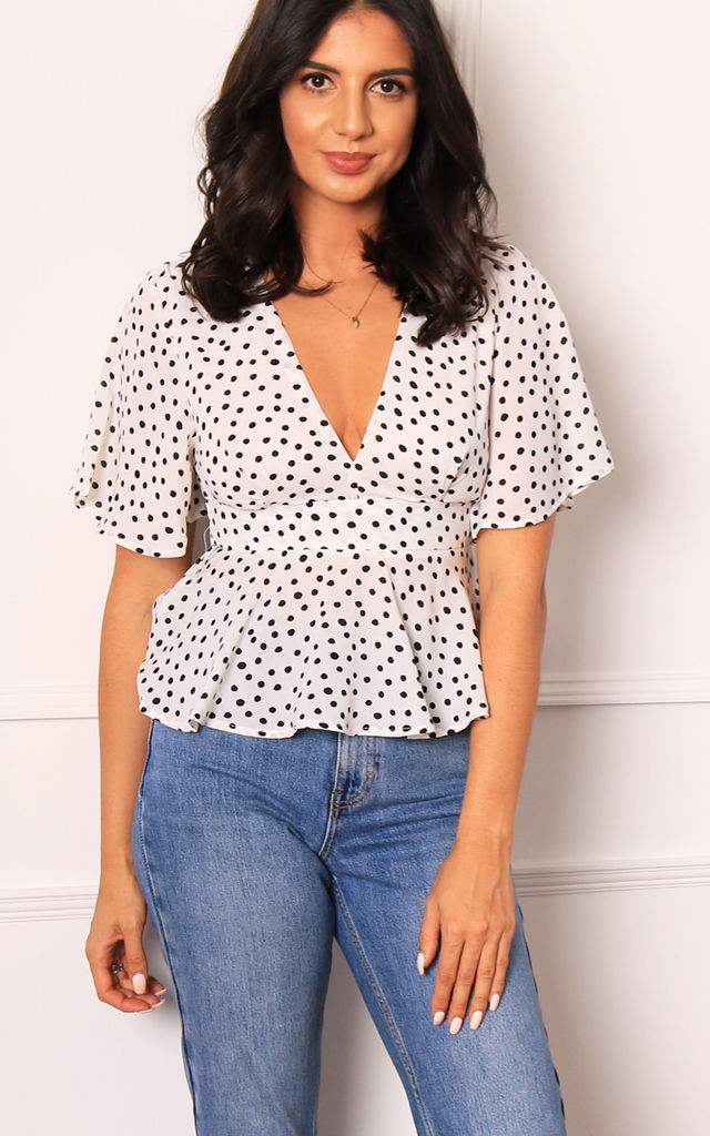 Polka Dot Open Back Peplum Hem Blouse Top in Soft Cream & Black by One Nation Clothing