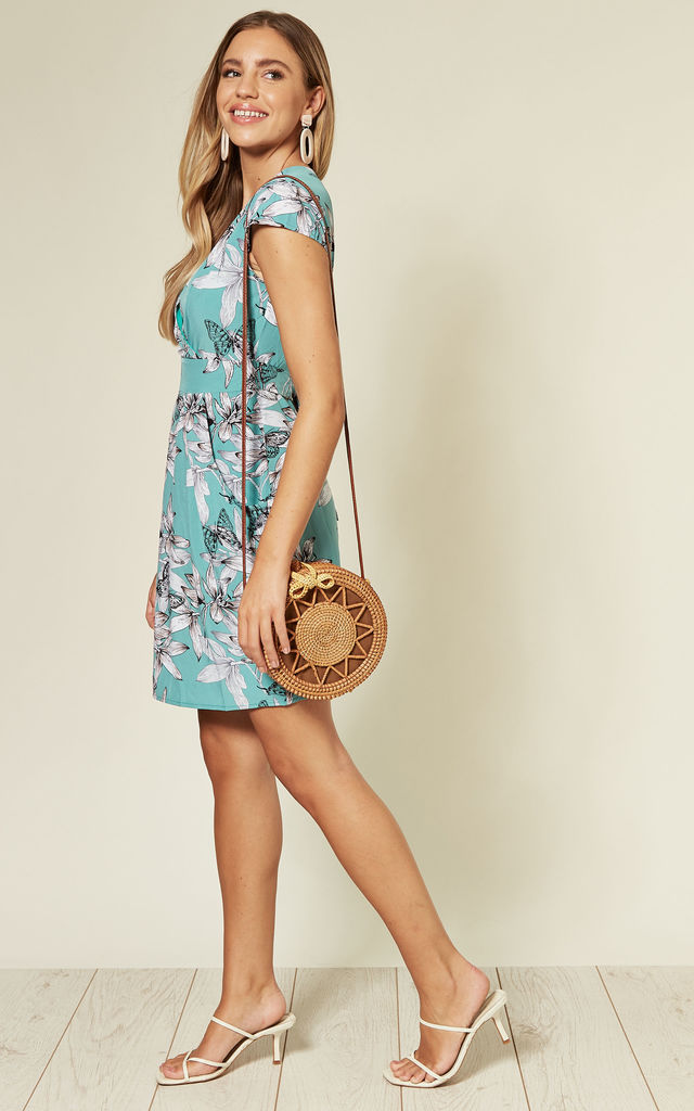 WRAP TULIP DRESS with V NECK in MINT GREEN FLORAL PRINT by TENKI LONDON