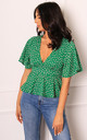 Polka Dot Open Back Peplum Hem Polka Dot Blouse Top in Green & White by One Nation Clothing