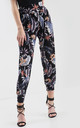 High Waisted Harem Trousers in Black Tropical Print by Oops Fashion