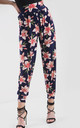 High Waisted Harem Trousers in Pink Floral Print by Oops Fashion