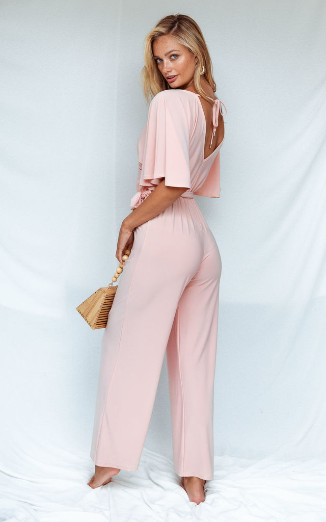 BRANDY JERSEY WRAP ANGEL SLEEVE JUMPSUIT IN BLUSH by Style Cheat