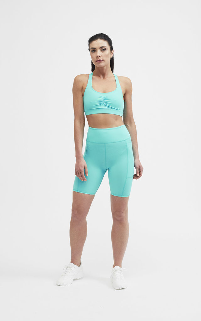 The Sian Sports Bra in Turquoise by Belles of London