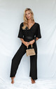 BRANDY JERSEY WRAP ANGEL SLEEVE JUMPSUIT IN BLACK by Style Cheat