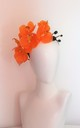 Large orange orchid occasion hairpiece by Kate Coleman
