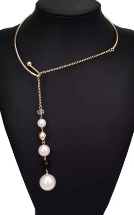 Silver asymmetric pearl drop torque choker by Lovelock jewels