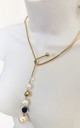 Gold asymmetric pearl and bead drop torque choker by Lovelock jewels
