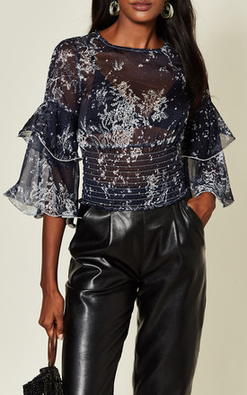 Midnight Navy Sheer Mesh Flowy Print Blouse With Layered Ruffle Sleeve And Deep Elasticated Hem by Off The Railz
