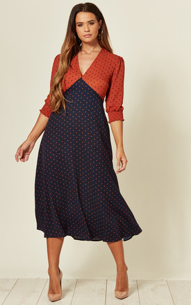 V Neck Midi Dress In Orange/Navy Polka Dot Print by LOVE SUNSHINE Product photo