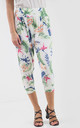 High Waisted Cropped Trousers in Cream Tropical Print by Oops Fashion