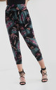 High Waisted Cropped Trousers in Black Tropical Print by Oops Fashion