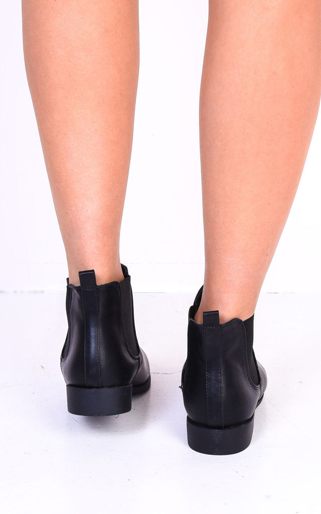 Black faux leather chelsea ankle boots with elastic insert by LILY LULU FASHION