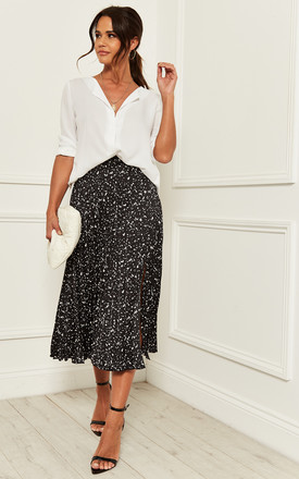 Pleated Midi Skirt In Black Speckle Print by Bella and Blue Product photo