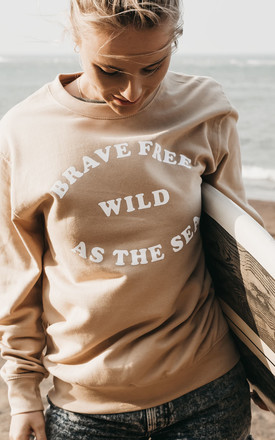 'Brave Free Wild As The Sea' Slogan Sweatshirt in Sand by ART DISCO