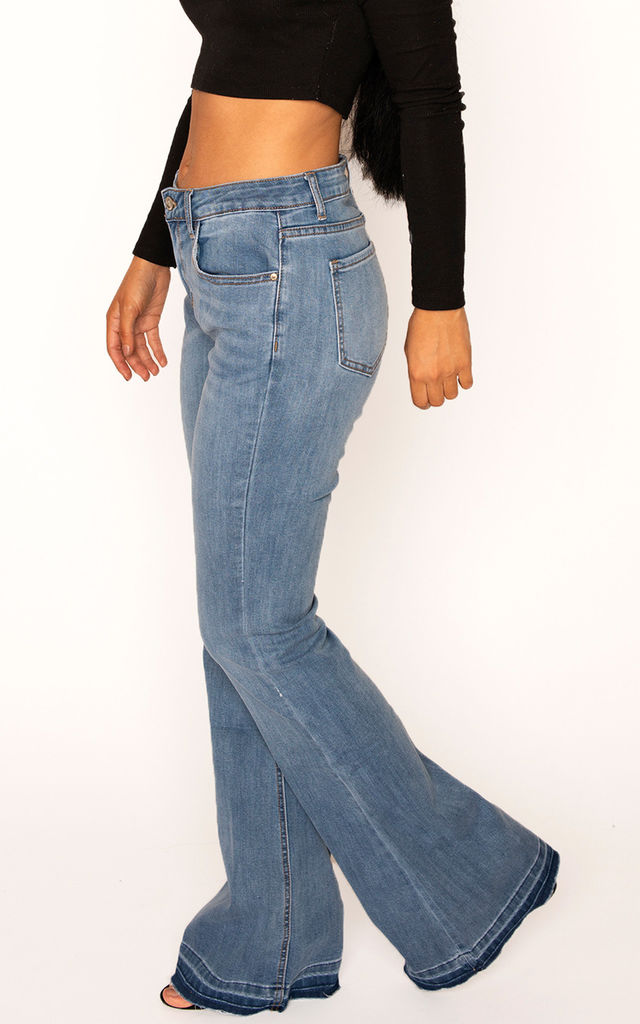 Faded Blue Bootcut Jeans with Raw Hem by Glamour Outfitters