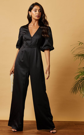 Satin Jumpsuit With Buttons & Puff Sleeve In Black by Phoenix & Feather Product photo